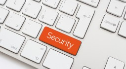 Security key on a white keybord - Shutterstock